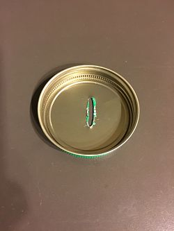 Photo of inside of Jar Lid with hammered-down sharp edges
